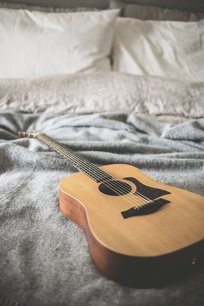 Guitar on bed